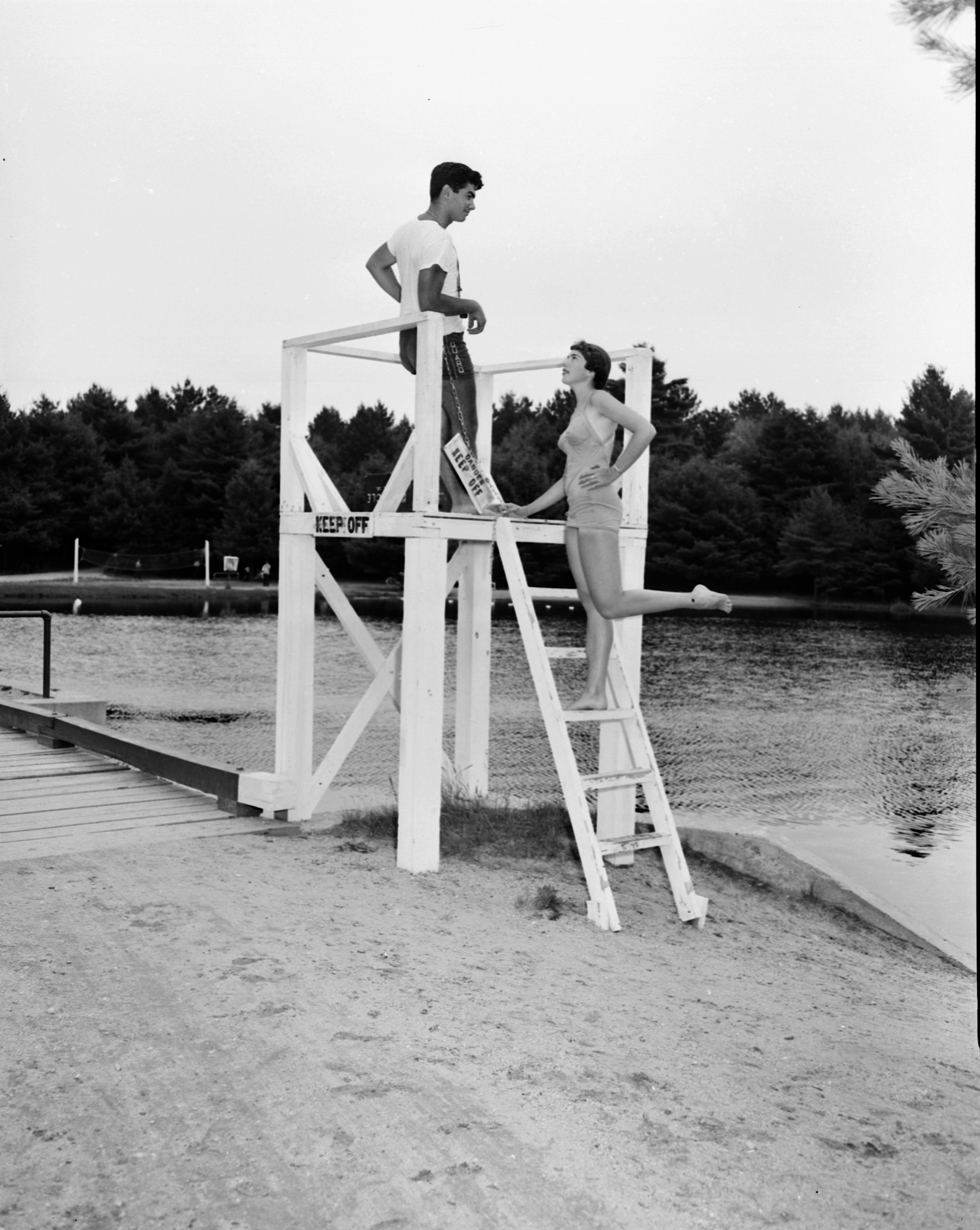 Lifeguards Chatting on the Beach, July 18, 1951