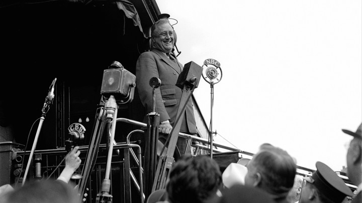 FILE - In this April 13, 1934 file photo, President Franklin D. Roosevelt smiles as he speaks to a Congressional welcoming committee which met him at Union Station on his return to Washington. (AP Photo)