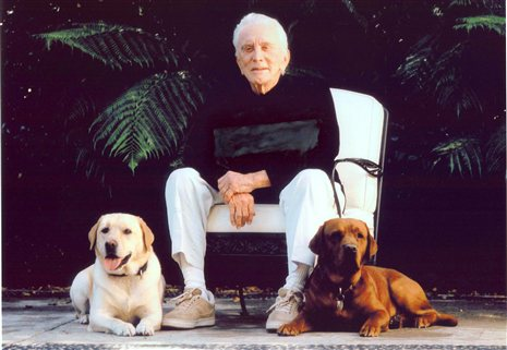 Kirk-Douglas-With-His-Dogs